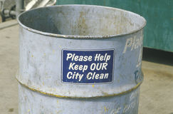 A sign that reads �Please help keep OUR city clean� Royalty Free Stock Photo
