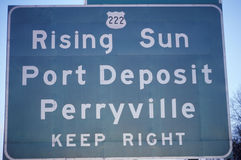 A sign that reads �Rising Sun Port Dempsey Perryville Keep Right� Stock Photography