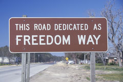 A sign that reads �This road dedicated as Freedom Way� Stock Image
