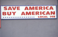 A sign that reads �Save America Buy American� Royalty Free Stock Photo