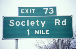 A sign that reads �Society Rd 1 mile� Stock Image