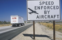 A sign that reads �Speed enforced by aircraft� Royalty Free Stock Images