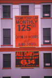 A sign that reads �Store your car monthly $125� Stock Photo