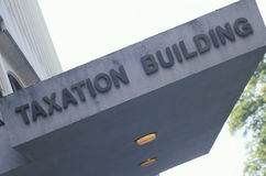 A sign that reads �Taxation Building� Stock Image