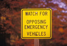 A sign that reads �Watch for opposing emergency vehicles� Stock Image