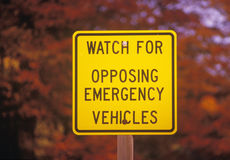 Sign that reads Watch for opposing vehicles Royalty Free Stock Image