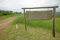 Sign reads Welcome to Hluhluwe Umfolozi Park, South Africa Royalty Free Stock Images