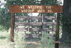 A sign that reads �We welcome you - worship with us� Royalty Free Stock Image