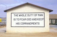 A sign that reads The whole duty of man is to fear God and keep his commandments Royalty Free Stock Photos