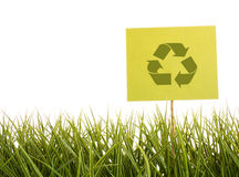 Sign with recycle symbol in the grass  Royalty Free Stock Photography