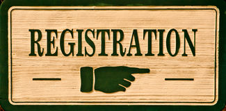 Sign - Registration. Carved Sign: Registration -  to notify guests the location to sign up for their reservations Stock Images
