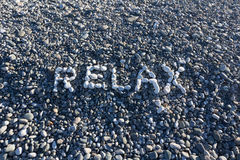 The sign Relax made from white pebbles on pebble beach on the se. A Stock Photo