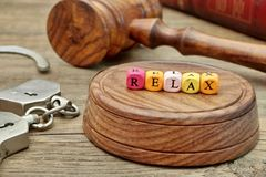 Sign Relax on the Soundboard, Judges Gavel, handcuffs and book i Royalty Free Stock Photos