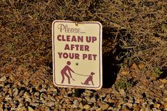 Sign reminding pet owners to clean up stock fotografie