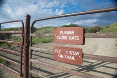 Sign reminds visitors to close the gate Stock Images