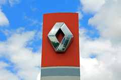 Sign Renault against Blue Sky with Clouds Stock Image