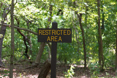 Sign: Restricted Area. A sign marking off a restricted are in the woods Royalty Free Stock Photos