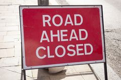 Sign road ahead closed. Sign indication that road ahead is closed on the street Stock Image