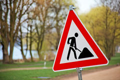 Sign and road signs at construction site Royalty Free Stock Image