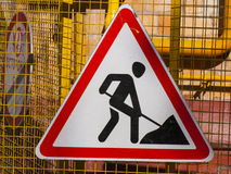 Sign road works. Red triangle sign depicting man with a spade Stock Images