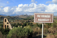 Sign and ruins of aqueduct Royalty Free Stock Image