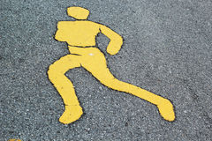 Sign runners yellow on road Royalty Free Stock Photography