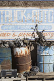 Sign And Rusty Barrels In Junkyard Royalty Free Stock Images