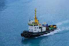Safety First Tugboat on Blue Water Royalty Free Stock Photos