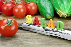 Sign Salad Made From Wood Letters And Fresh Local Vegetables Stock Photos