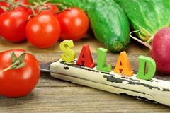 Sign Salad Made From Wood Letters And Fresh Local Vegetables Stock Photo