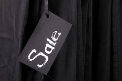 Sign Sale on black pants and jeans background. Copy space.  friday. Close up. Stock Photos