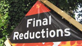 Sign. sale sign. final reductions. final reductions sign. Seasonal store outdoor sign of final price reduction Royalty Free Stock Photography