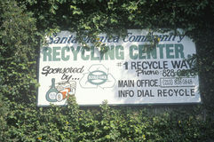 A sign for the Santa Monica Community Recycling Center obscured by leaves Royalty Free Stock Images