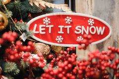 Sign saying let it snow. Red and white stock photos
