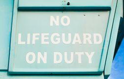 Sign saying No Lifeguard On Duty stock image