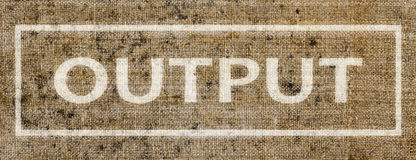 A sign saying Output on a piece of old canvas Royalty Free Stock Photography