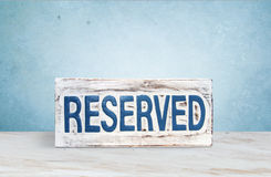 A sign saying reserved. A sign wood saying reserved Royalty Free Stock Photo