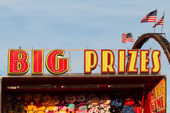 Sign Says Big Prizes At County Fair Carnival Game. Lawrenceville, GA, USA - September 17, 2016:  `Big Prizes` sign sits atop carnival game filled with stuffed Royalty Free Stock Photos
