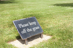 Sign that says keep off the grass Royalty Free Stock Images