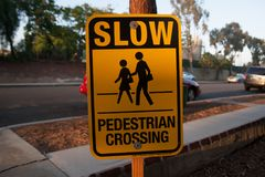 Sign says SLOW PEDESTRIAN CROSSING on the street of Los Angels, America. Street signs means the traffic rule, advertising, or many. Things stock image
