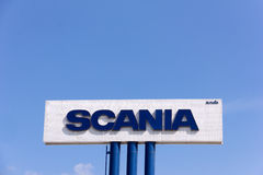 Sign Scania against blue sky. stock photography