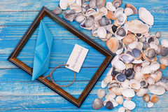 Sign Sea adventure and paper Boat with shells and photo frame Stock Photos