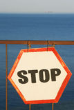 Sign at the sea shore. The sign prohibiting the entrance to the sea located on the beach Royalty Free Stock Photo
