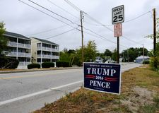 Trump for president sign seen in a US suburb, near a speed limit sign. royalty free stock photos