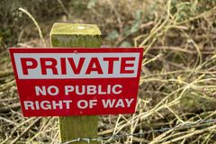 Newly erected Private sign seen on the border of public land in a forest. royalty free stock photos