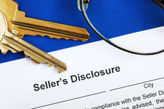 Sign the seller disclosure statement. In a real estate transaction Royalty Free Stock Photo