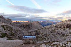 Sign and Sexten Dolomites mountains panorama with Alpenglow at sunrise in South Tyrol. Italy Stock Images