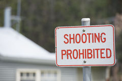 Sign shooting prohibited residential area Royalty Free Stock Image