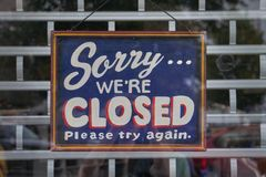 Sorry we`re closed signs. Sign in shop window saying Sorry we`re closed Stock Photography