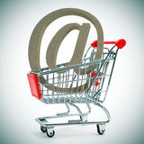 At sign in a shopping cart royalty free stock photo